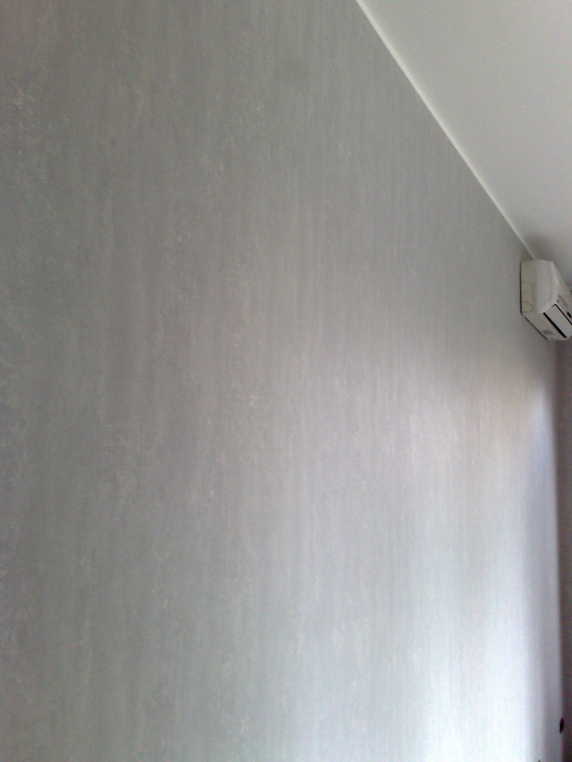 Imbiancatura e pittura murale effetto spugnato grigio tele